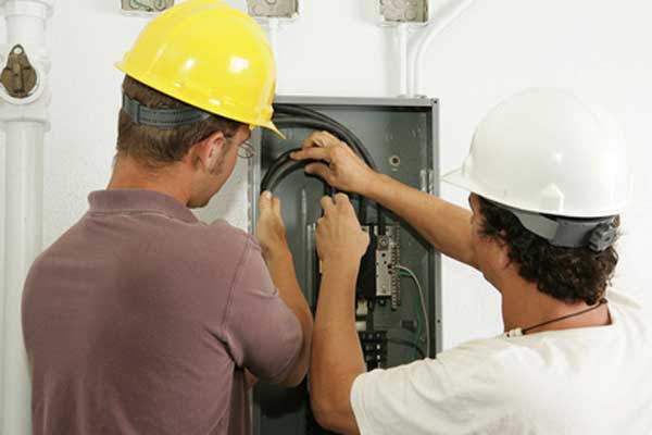Men Working on Electrical Panel